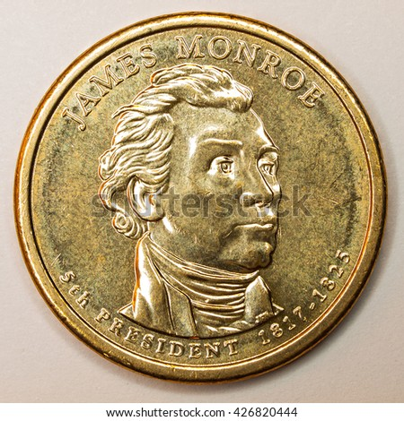 US Gold Presidential Dollar Featuring James Monroe - stock photo