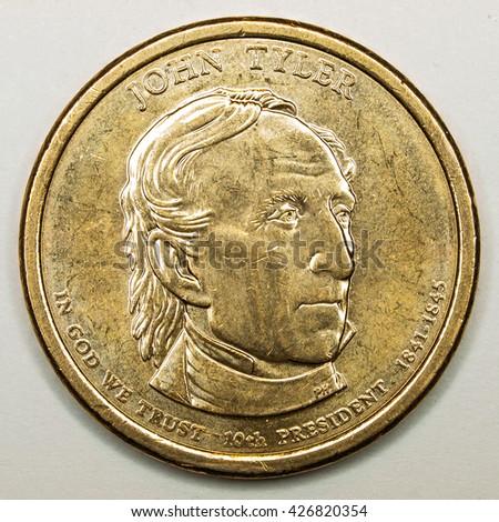 US Gold Presidential Dollar Featuring John Tyler - stock photo