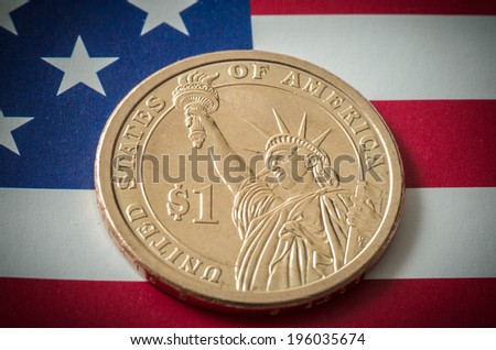 US Liberty Dollar Coin with the US american flag as background - stock photo