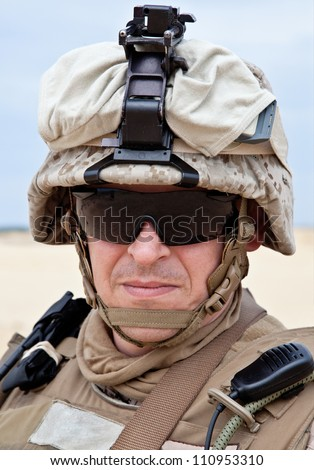 US marine in the desert uniform and protective military eyewear - stock photo