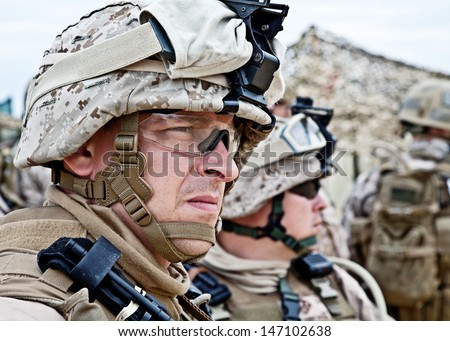 US marine in the MARPAT uniform and protective military eyewear - stock photo
