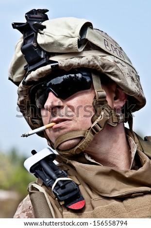 US marine smoking - stock photo