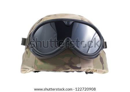us marines kevlar helmet with a multicam camouflage cover and protective goggles - stock photo
