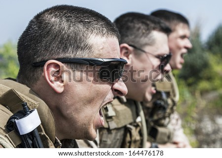 US Marines shouting at somebody showing war face - stock photo
