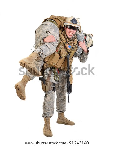 US Marines: soldier evacuating his wounded mate - stock photo