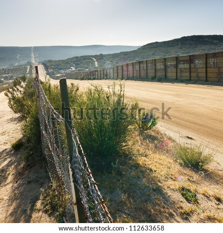 US/Mexico border fence near Campo, California, USA - stock photo