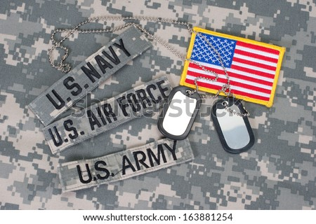 US military concept on camouflage uniform - stock photo