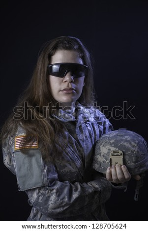 Us military woman with helmet and tactical glasses - stock photo