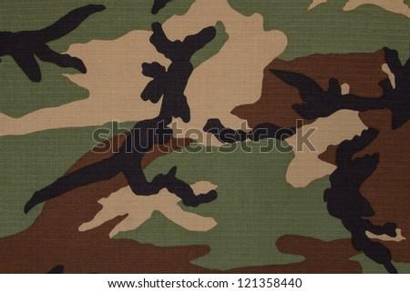 US military woodland camouflage fabric texture background - stock photo