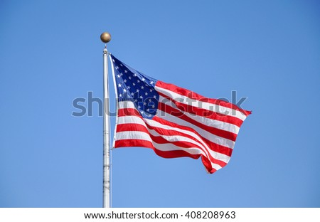 US National Flag in blue sky.