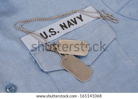 us navy uniform with blank dog tags - stock photo