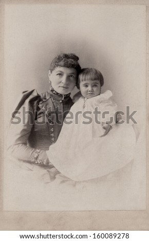 US - New York - CIRCA 1890 - A vintage photo of a young mother with her daughter. A photo from the Victorian era. CIRCA 1890
