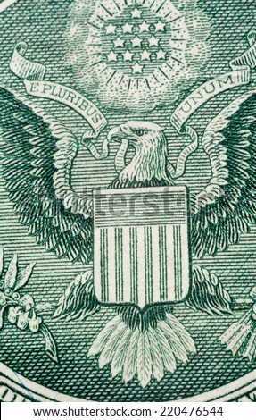 US one (1 ) dollar bill in a macro shot, super macro, close up photo.  Great Seal of the United States Logo.  - stock photo
