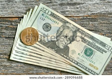 US Paper Money - 20 Dollar Bills and Gold Liberty Dollar Coin - stock photo