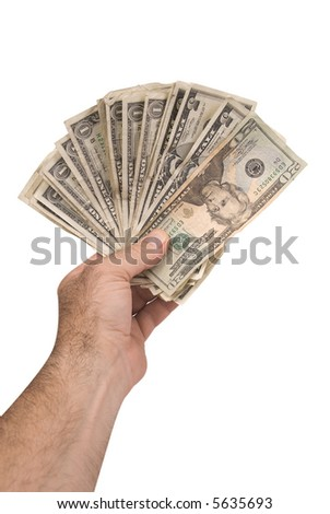 US paper money in a man's hand - stock photo