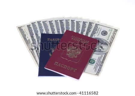 US Passport and Russian passport with stack of US 100 dollars bills