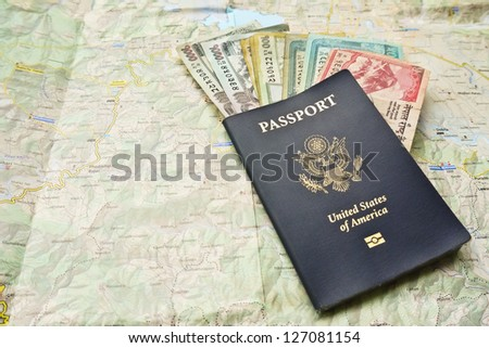 US Passport, Nepali rupees on a Pokhara Map