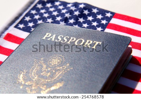 US passport over a red, white and blue flag background - stock photo