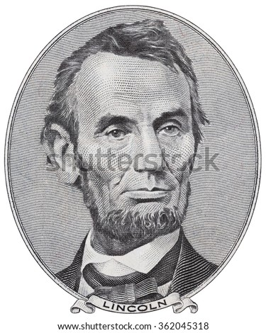 US President Abraham Lincoln on five dollar bill macro isolated, 5 usd, united states money closeup - stock photo