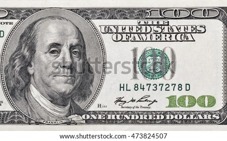 US President Benjamin Franklin portrait on one hundred dollar bill macro