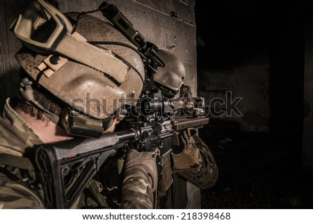 US rangers defending themselves behind concrete obstacle - stock photo