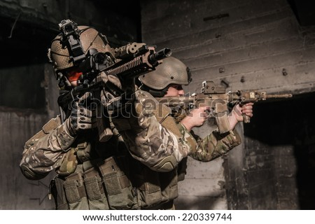 US rangers during patrol in urban area  - stock photo