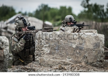 us rangers in position behind concrete blocks - stock photo