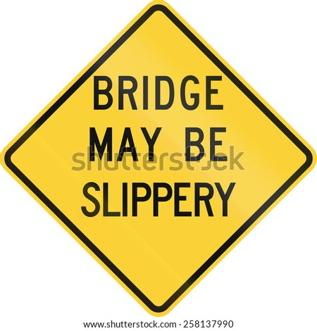 US road warning sign: Bridge may be slippery - stock photo