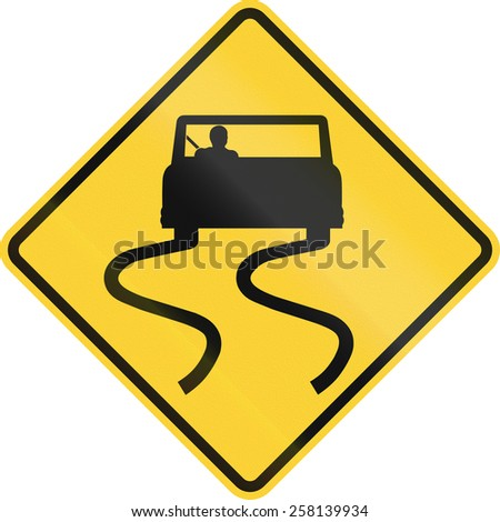 US road warning sign: Slippery when wet - stock photo