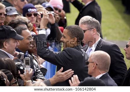 US Senator Barack Obama shakes hands at early vote for change Presidential rally, October 29, 2008 at Halifax Mall, Government Complex in Raleigh, NC - stock photo