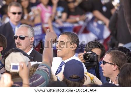 US Senator Barack Obama shaking hands at Early Vote for Change Presidential rally, October 25, 2008 at Bonanza High School, Judy K. Cameron Stadium in Las Vegas, NV - stock photo