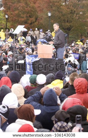 US Senator Barack Obama speaking at podium in pouring rain at Presidential Rally on October 28, 2008, at Widener University in Chester, PA - stock photo