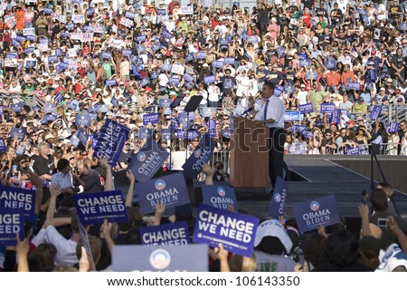 US Senator Barack Obama speaking from podium at Early Vote for Change Presidential rally, October 25, 2008 at Bonanza High School, Judy K. Cameron Stadium in Las Vegas, NV - stock photo