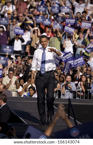 US Senator Barack Obama waving to crowd at Early Vote for Change Presidential rally, October 25, 2008 at Bonanza High School, Judy K. Cameron Stadium in Las Vegas, NV