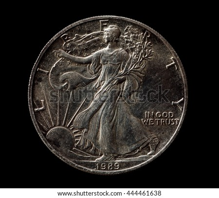 US silver liberty dollar isolated on black, closeup macro shot