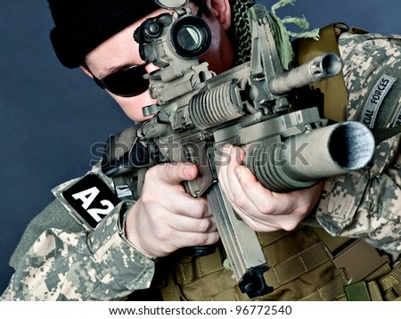 US soldier aiming with his assault rifle - stock photo