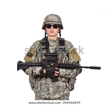 US soldier holding his assault rifle isolation on white - stock photo
