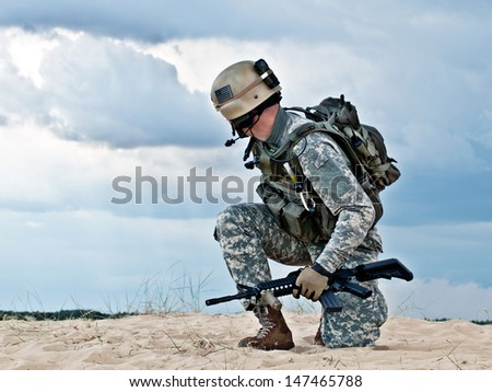 US soldier in the desert during the military operation - stock photo