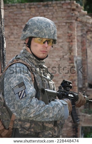 US Soldier on urban patrol mission - stock photo