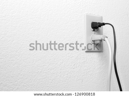 US style electric receptacle in use. - stock photo