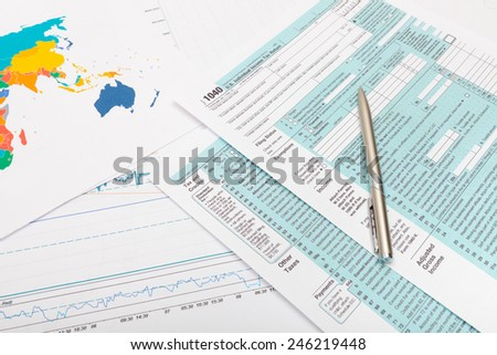 US 1040 Tax Form and silver ball pen over it - stock photo