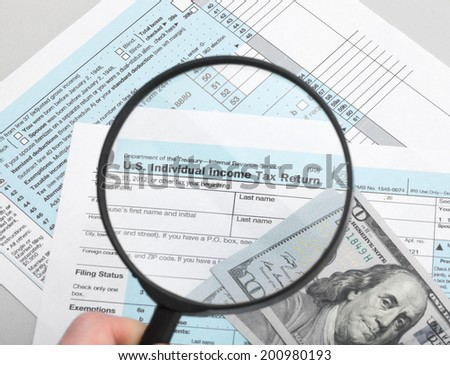 US Tax Form 1040 with magnifying glass