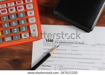 US tax form with pencil,wallet and calculator selective focus / taxation concept