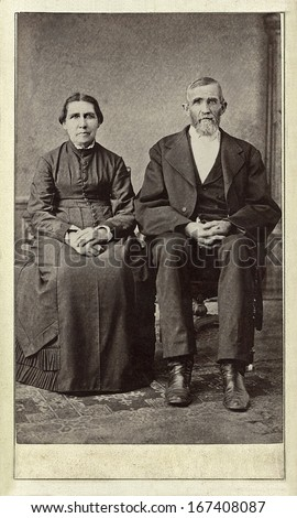 US - WISCONSIN - CIRCA 1860 - A vintage Cartes de visite photo of an elderly couple. The man and wife are sitting next to each other. A photo from the Civil War era. CIRCA 1860