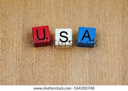 USA - acronym United States of America in red, white and blue colors of stars and stripes national flag. - stock photo