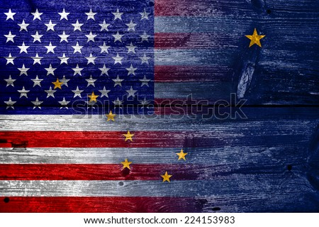 USA and Alaska State Flag painted on old wood plank texture