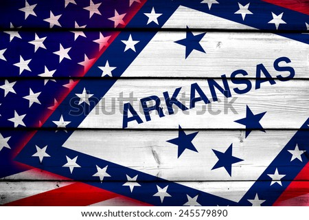 USA and Arkansas State Flag on wood background - stock photo