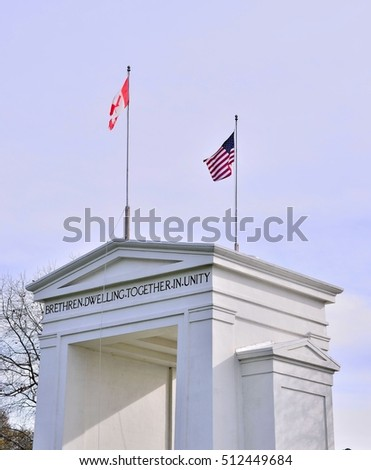 USA and Canada flag by the border