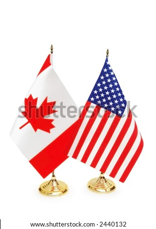 Usa and Canada flags isolated on white - stock photo