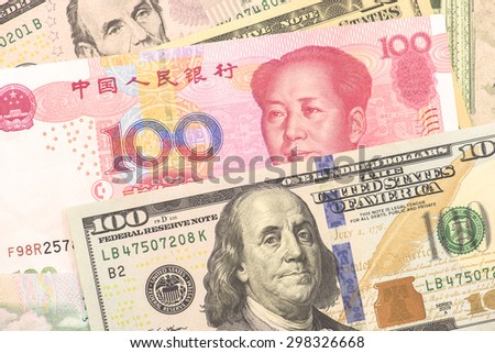 USA and Chinese banknotes - stock photo